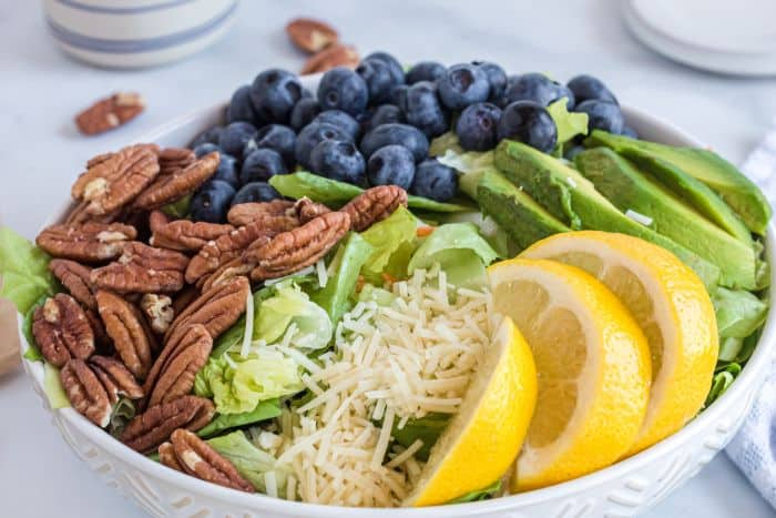 salad with pecans, blueberries, avocado, Parmesan, and lemon