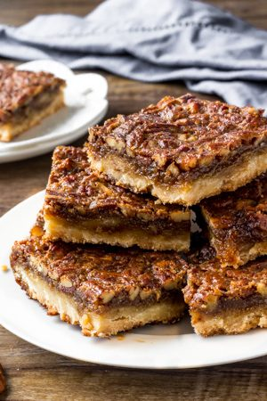 Pecan pie bars have a buttery shortbread base, delicious butterscotch flavor, and crunchy pecans.