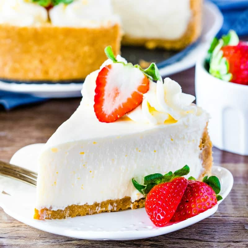 Perfectly Easy No-Bake Cheesecake is creamy with a silky smooth texture and crunchy graham cracker crust. Learn all the tricks for the perfect cheesecake!