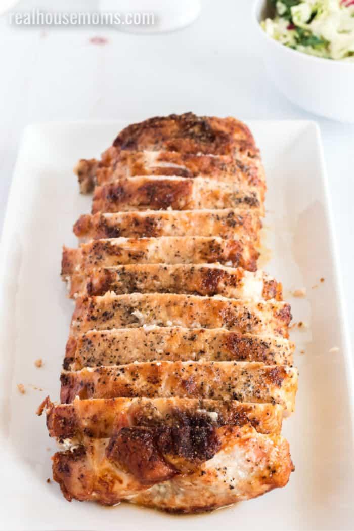sliced pork loin on a serving platter