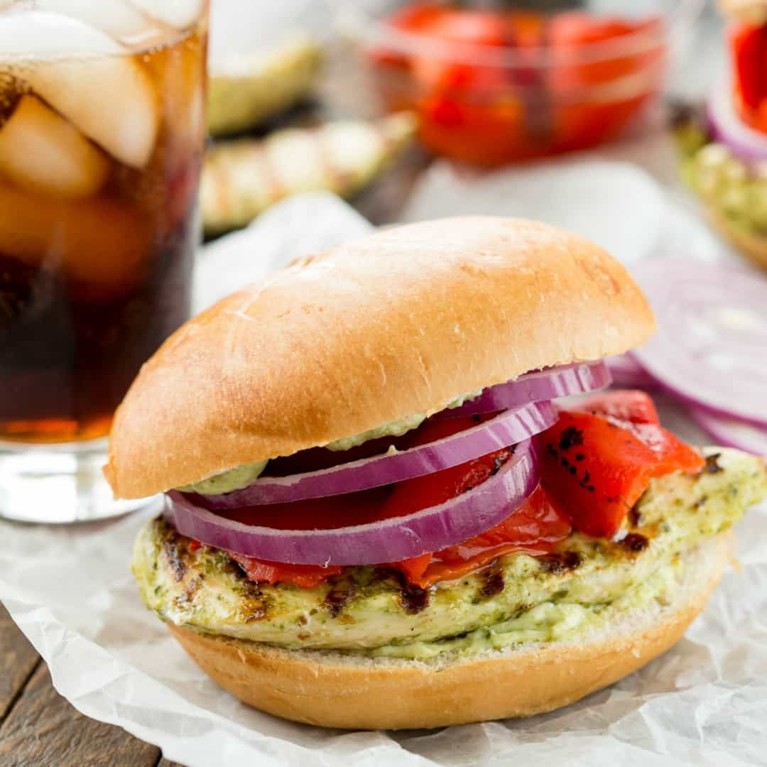 This Grilled Pesto Chicken Sandwich is delicious topped with a pesto mayonnaise, roasted bell pepper, and purple onion!