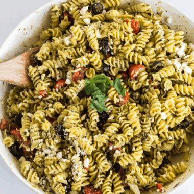Pesto Pasta Salad is light, fresh, and chocked-full of amazing flavor. It's so simple to make that it's a MUST-HAVE for any potluck or picnic!