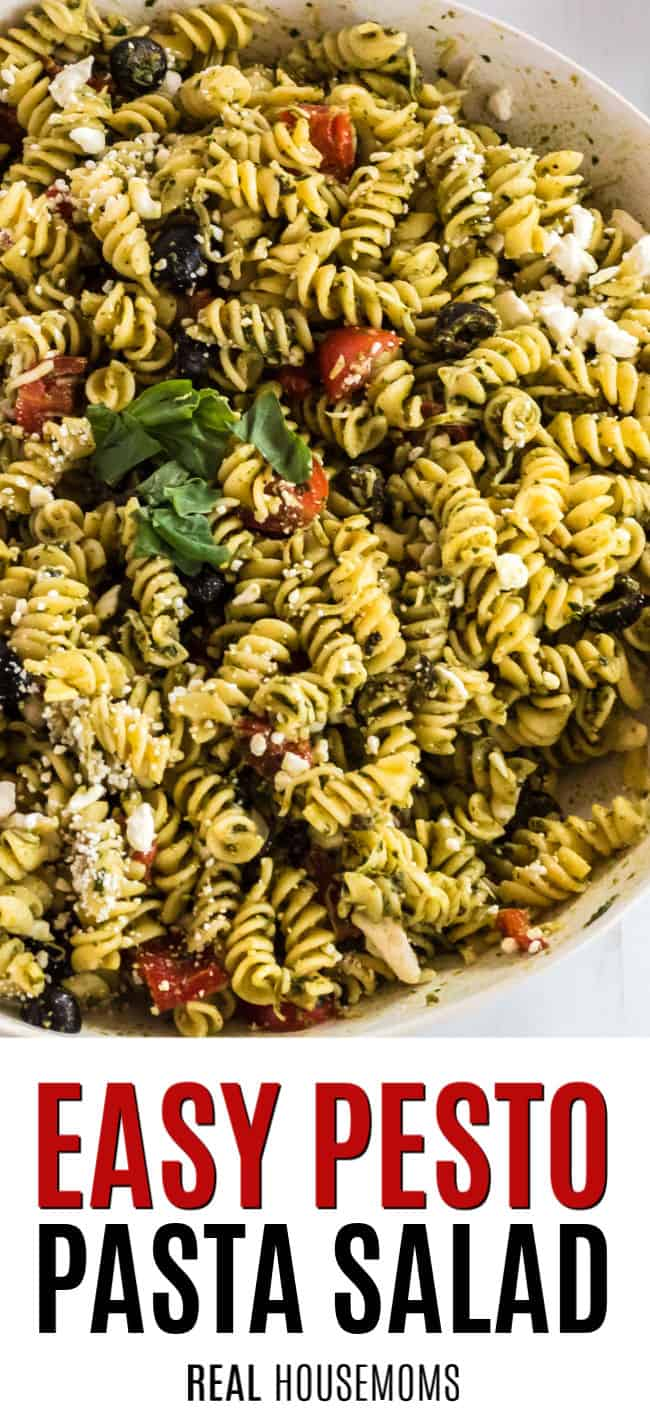 close up of pesto pasta salad in a serving bowl