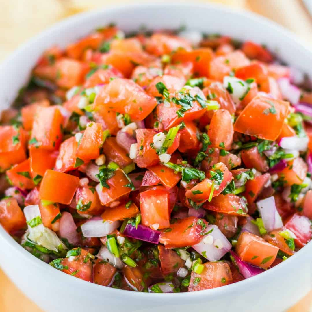 Pico De Gallo is my favorite way to add fresh tangy flavor to Latin-inspired meals. It comes together quickly, easily and you likely already have most of the ingredients needed in your kitchen!