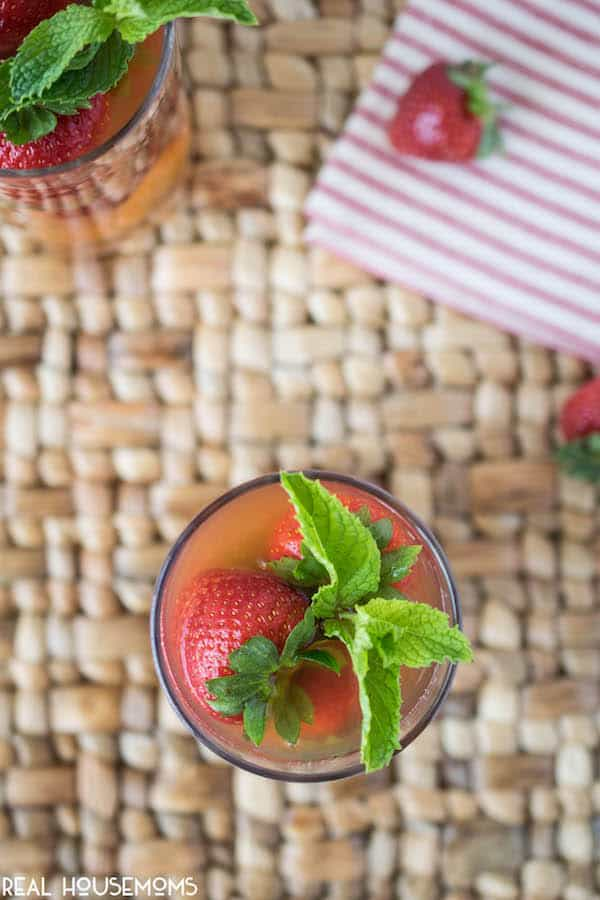 Pimm's is Englands number one choice when mixing up a delicious summer drink. This PIMM'S STRAWBERRY MINT COCKTAIL is cooling, refreshing and perfect to get you through the sunny season!