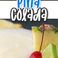 frozen pina colada with pineapple Lime and cherry garnish