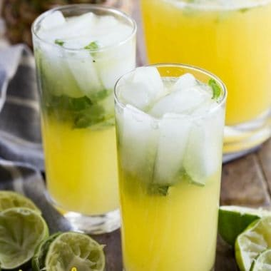 A refreshing PINEAPPLE LIMEADE made with a simple syrup, fresh basil, fresh lime juice, and plenty of pineapple. This is going to be your favorite mocktail ever!