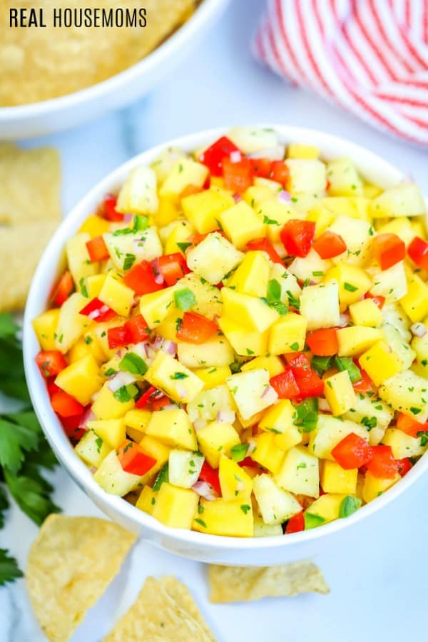 bowl of mango salsa served with tortilla chips