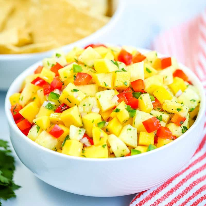 Easy, fresh and flavorful Pineapple Mango Salsa! Serve with tortilla chips or with grilled chicken, fish, tacos, and more!