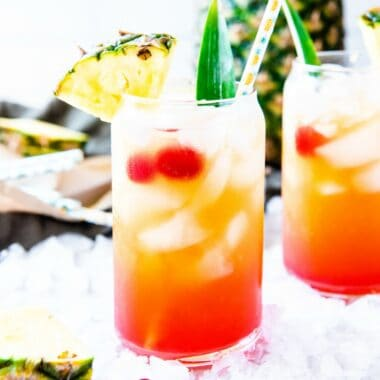 Throw your cares away while you enjoy this Pineapple Rum Punch! A pitcher of this fruity Caribbean cocktail will make you feel like you're on vacation!