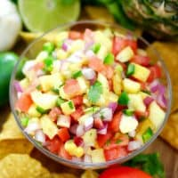 Fresh Pineapple Salsa is an incredibly easy recipe that wows with its colorful presentation.  Just a few simple ingredients and you have an appetizer that's flavorful & delicious!
