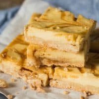 Praline Cheesecake Bars with a shortbread crust. You'll love the toffee bits and caramel swirls baked inside!