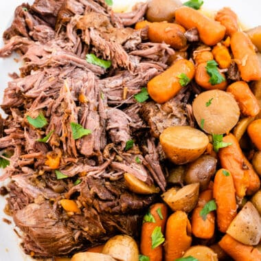 square image of shredded pot roast with potatoes and carrots