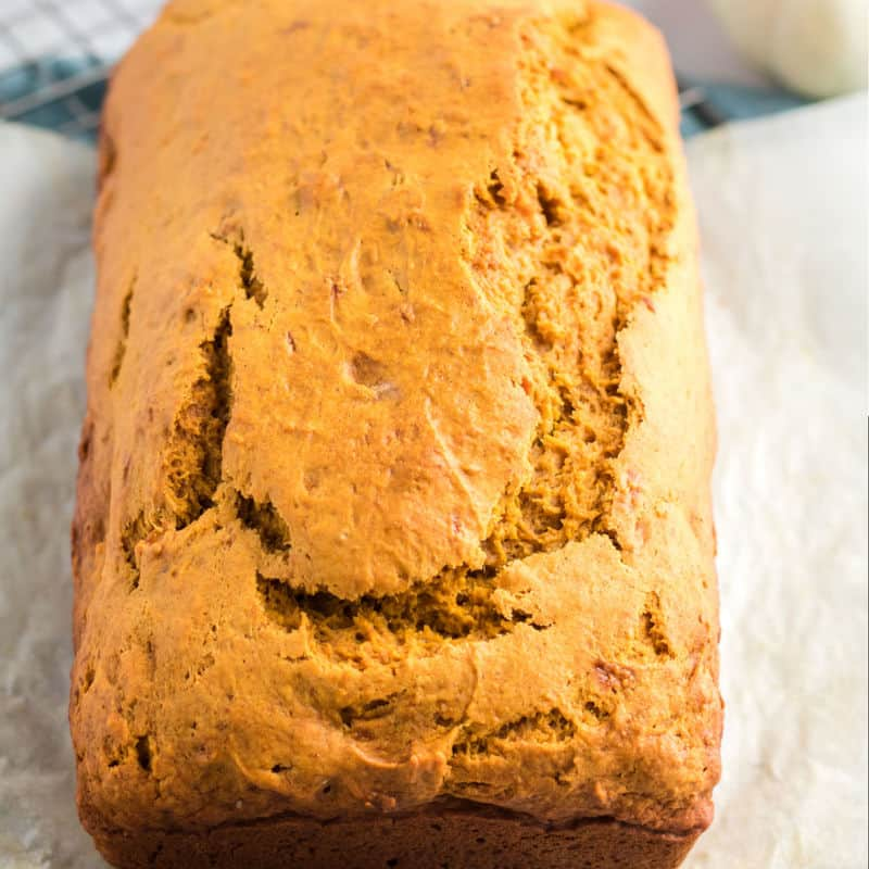 square image of a loaf of pumpkin banana bread