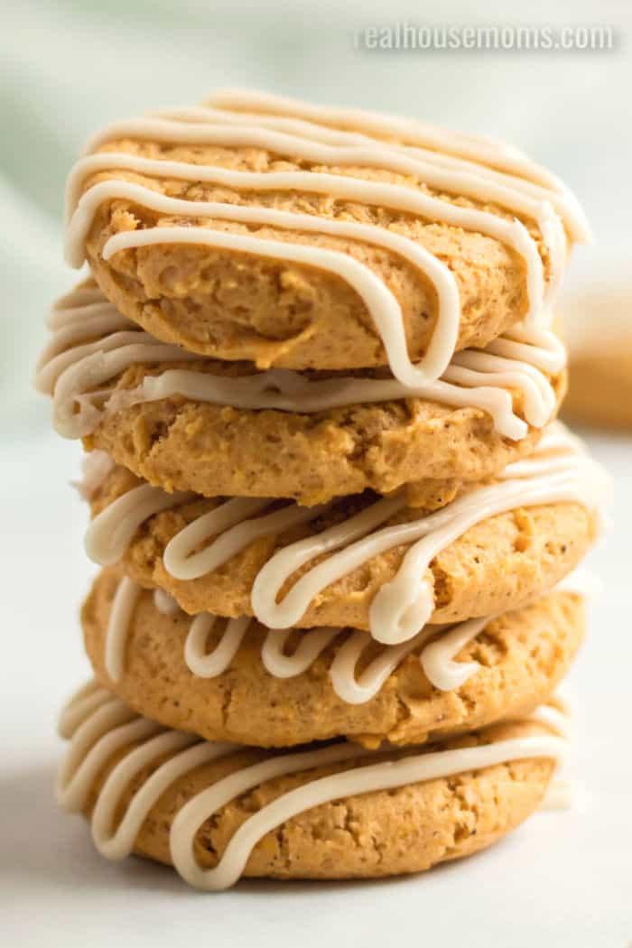 five pumpkin cookies stacked up