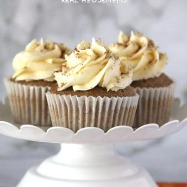 These delicious PUMPKIN SPICED CUPCAKES WITH VANILLA FROSTING are sure to be hit this holiday season!