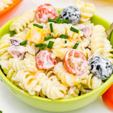 square image of ranch pasta sald in a small bowl with a fork