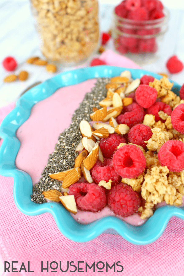 Loaded with protein and packed with flavor, this RASPBERRY ALMOND SMOOTHIE BOWL is s quick and easy breakfast is just as healthy as it is delicious!