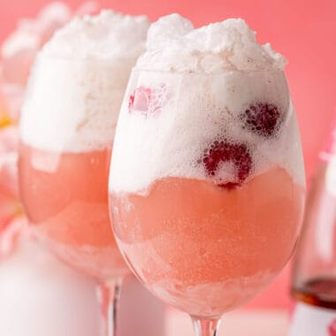 square image onf two raspberry wine floats in wine glasses