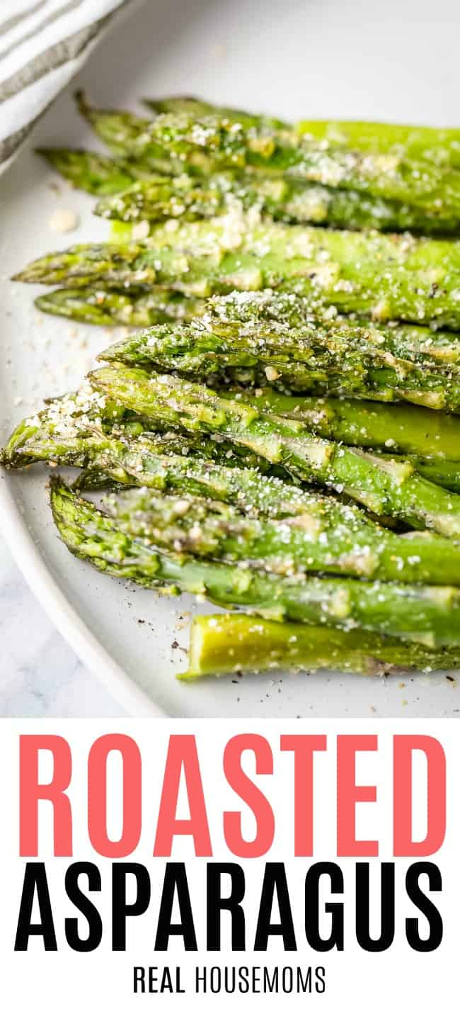 roasted asparagus piled up on a plate for serving