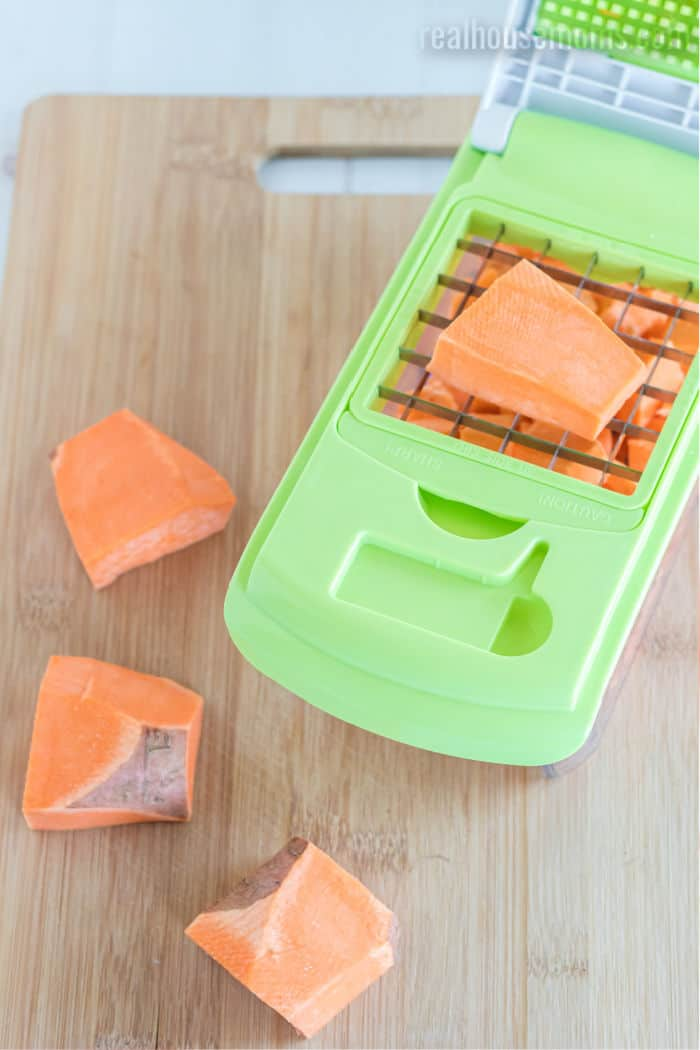 sweet potatoes being diced with a box cutter