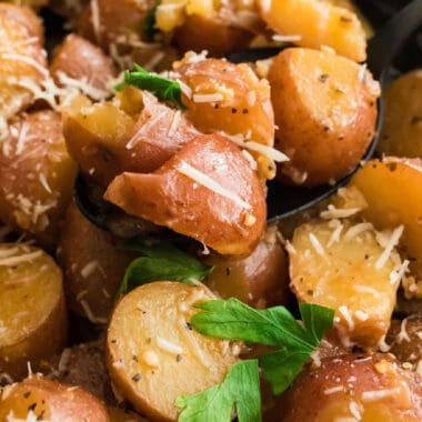 square close up image of rosemary & garlic instant pot potatoes on a spoon