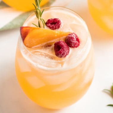 square image of rosemary peach tequila punch