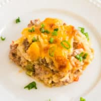 Loaded with hearty sausage and fresh veggies, this creamy, cheesy Sausage Hash Brown Casserole is easy to make and so delectable!