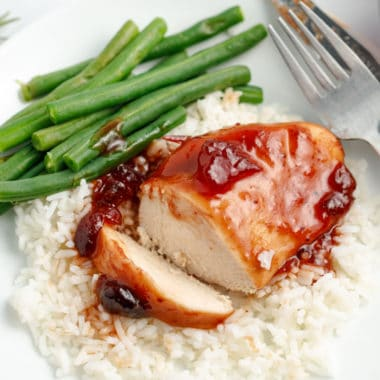 Sweet cranberry and tangy BBQ sauce give plain chicken breasts a sweet & savory spin that's hard to resist! Slow Cooker Cranberry Chicken is a crockpot win!