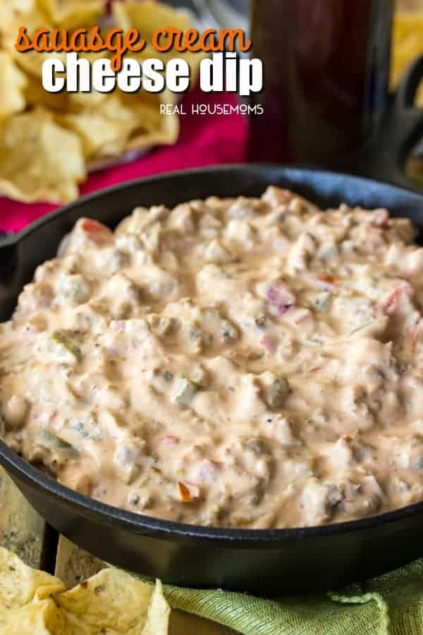 Sausage Cream Cheese Dip in a serving bowl with chips for dipping
