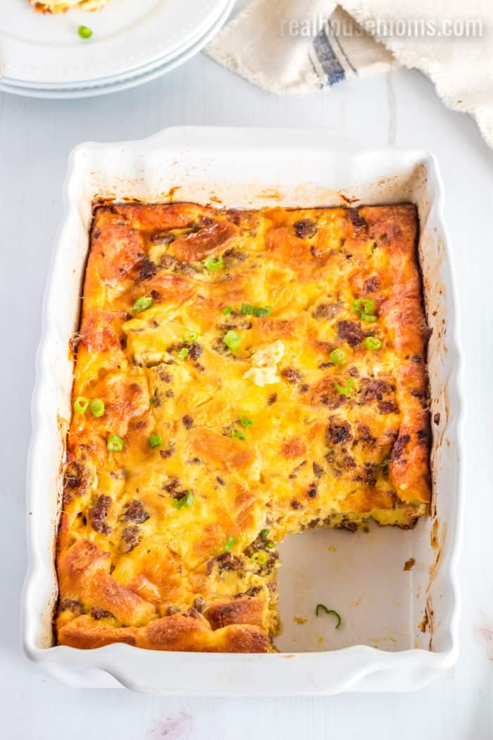 baking dish of breakfast casserole with a slice taken out