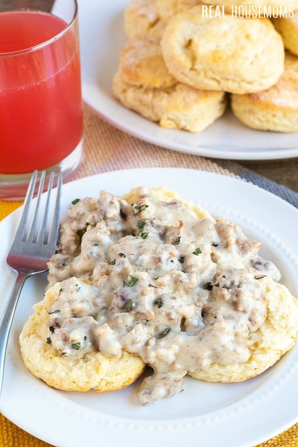biscuits and gravy on a plate with a fork