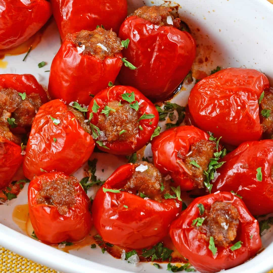 Sausage Stuffed Cherry Peppers are an easy and tasty appetizer that can be prepared ahead of time and popped in the oven ready to serve!