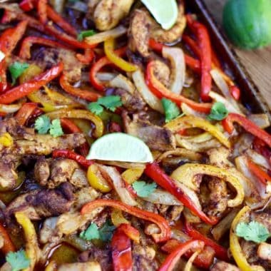 You have to try this incredible Sheet Pan Chicken Fajitas recipe!  A flavorful and healthy dish that's on the table in less than 30 minutes!