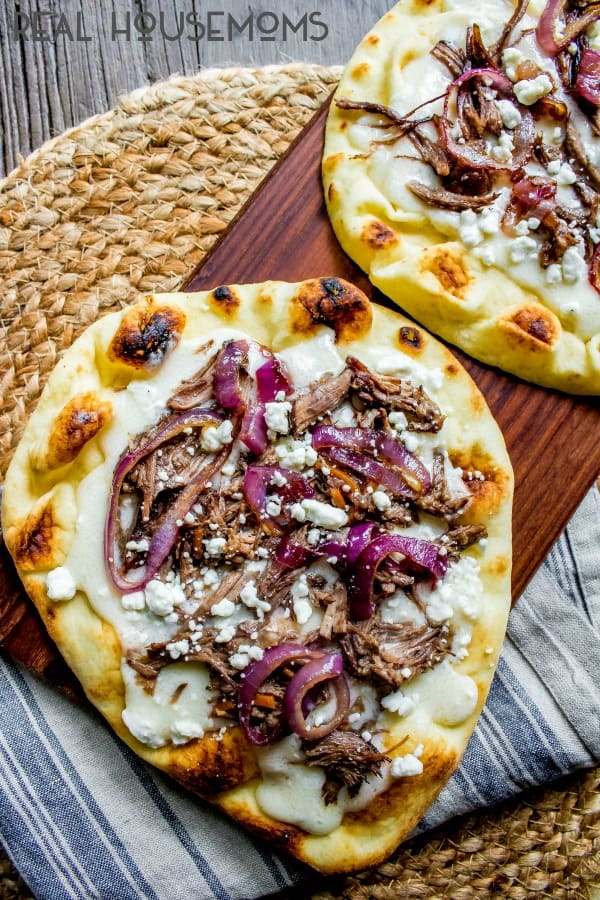 Cooked Short Rib Naan Pizza before being topped with arugula