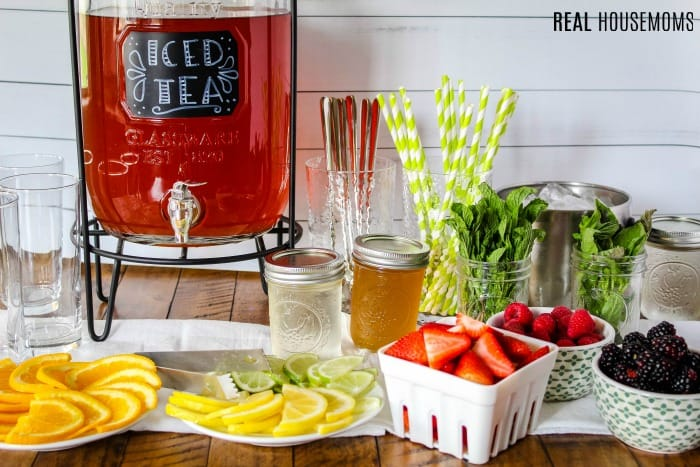 iced tea bar with fruits, herbs, and homemade simple syrups