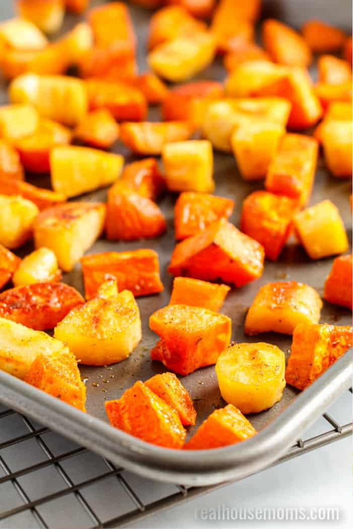 close up of roasted maple vegetables on a baking sheet
