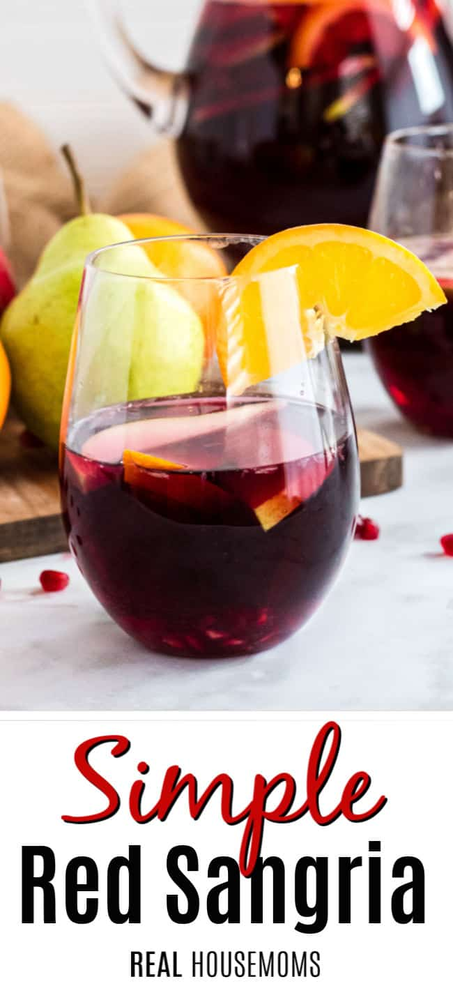 glass of red sangria with fruit and text