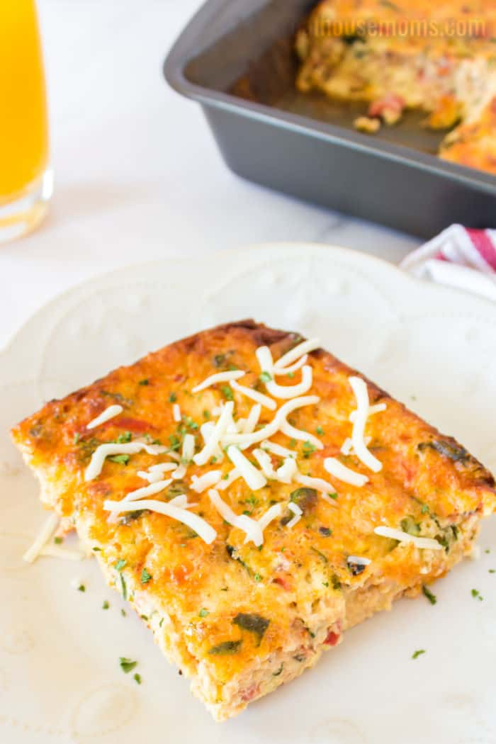 slice of breakfast casserole roped with cheese
