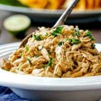 SLOW COOKER CHIPOTLE RANCH CHICKEN is juicy perfection that's a staple everyone needs in their back pocket! Incredibly versatile, flavorful chicken for tacos, burritos, nachos, soups, salads, etc. and all you do is dump and run!