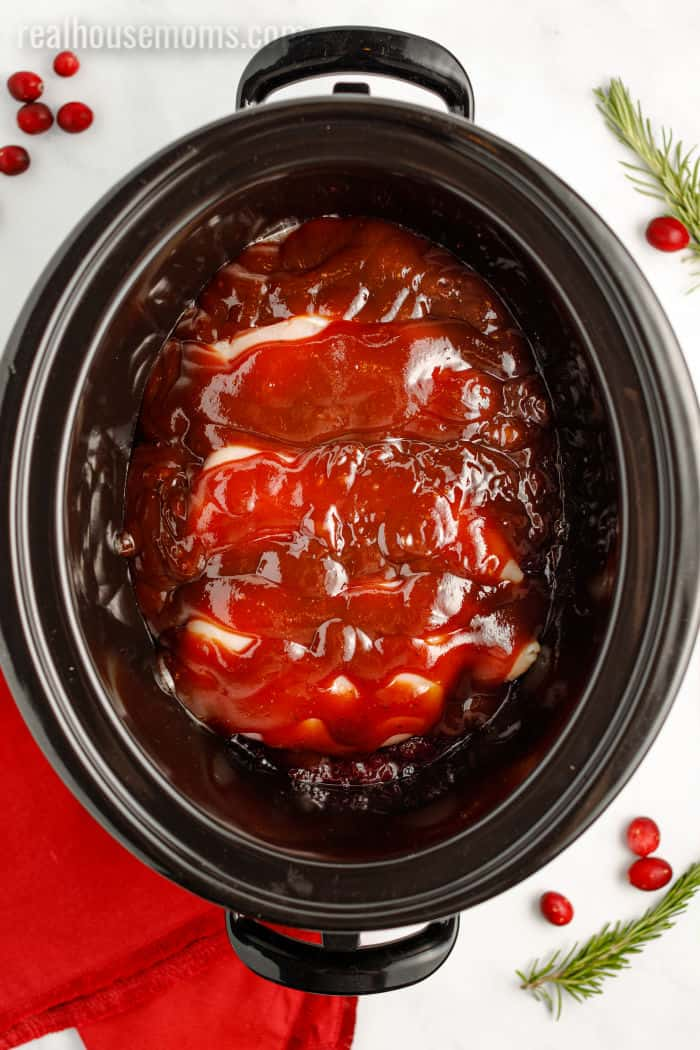 cranberry sauce, chicken, and bbq sauce in a crock pot