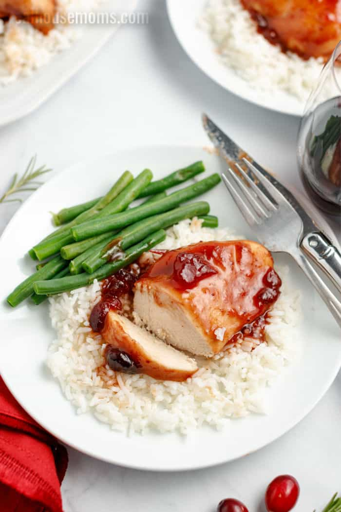 cranberry chicken cut open to show juicy chicken