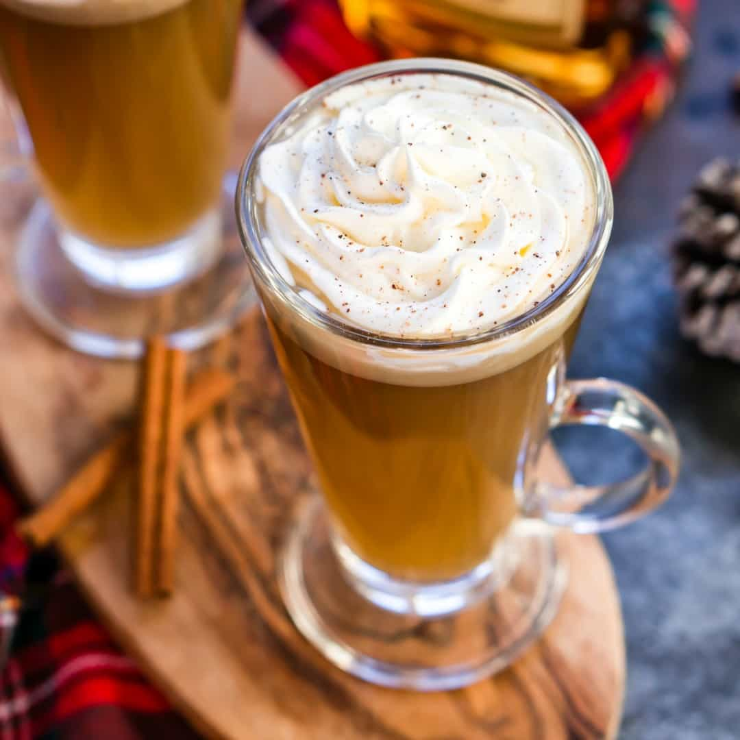 This Slow Cooker Hot Buttered Rum is a classic holiday drink you can mix in a crock pot in minutes and let it simmer all day long!