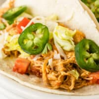square close up of image of slow cooker queso chicken taco