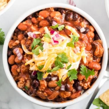 Slow Cooker Taco Chili is the ULTIMATE hearty comfort food. It's warm, meaty, and has a slight kick to keep you wanting more!