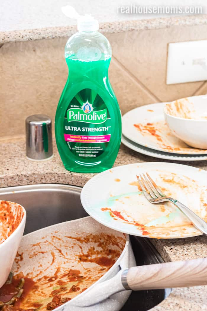 palmolive with dirty dishes at the sink