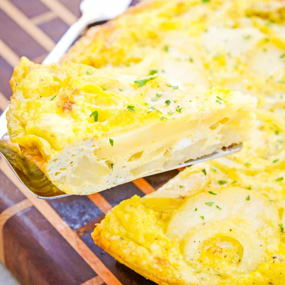 Spanish Tortilla is a Spanish omelet made with fried potatoes and onions, eggs and olive oil. The perfect brunch or make-ahead breakfast recipe!