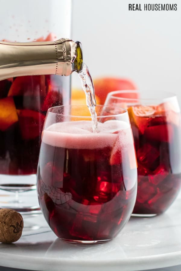 prosecco being poured onto sangria