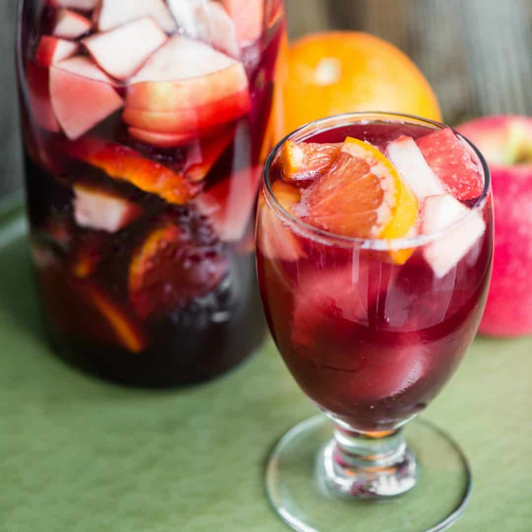 My Sparkling Red Wine Sangria Recipe is an easy make-ahead cocktail! Perfect for serving a crowd on any occasion & you can snack on when your drink's done!