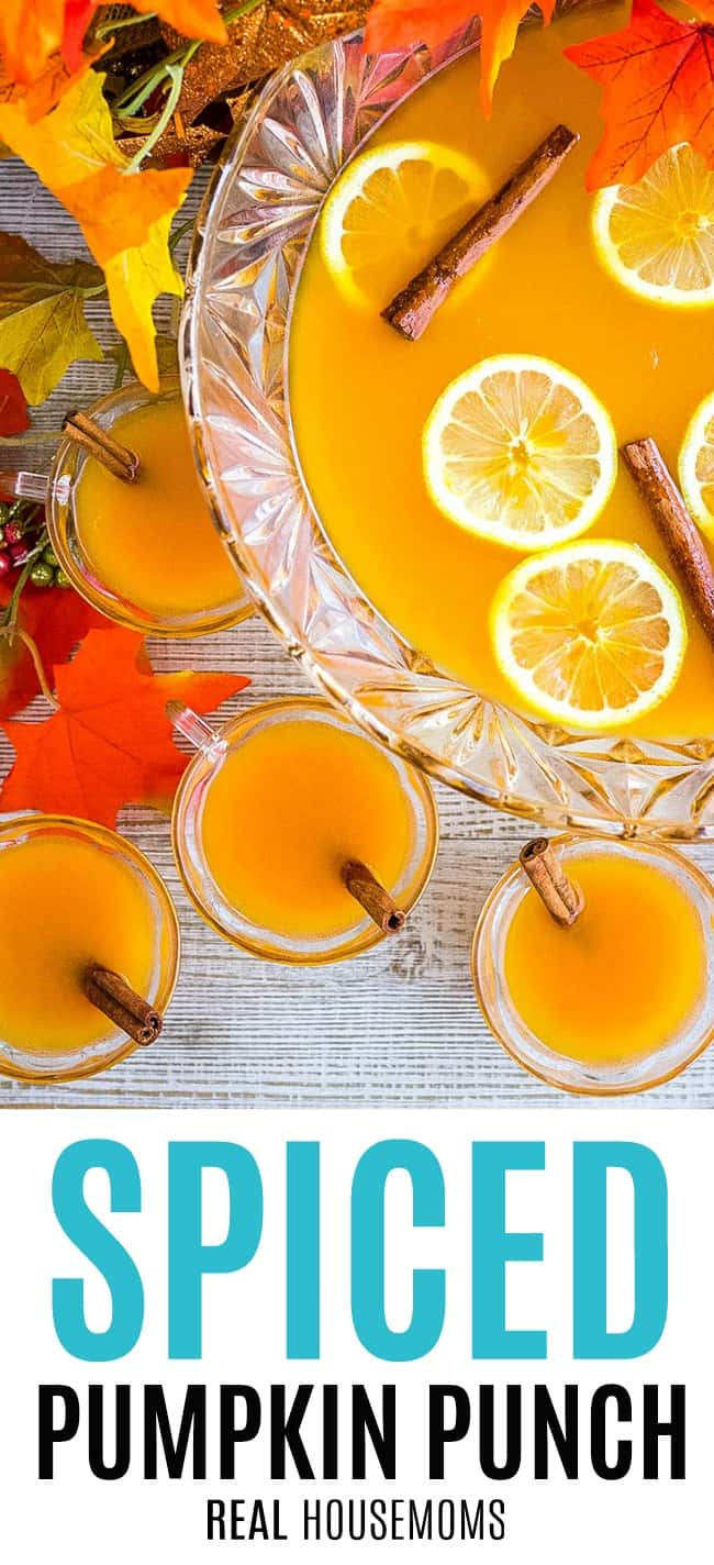 spiced pumpkin punch in a punch bowl with filled glasses around